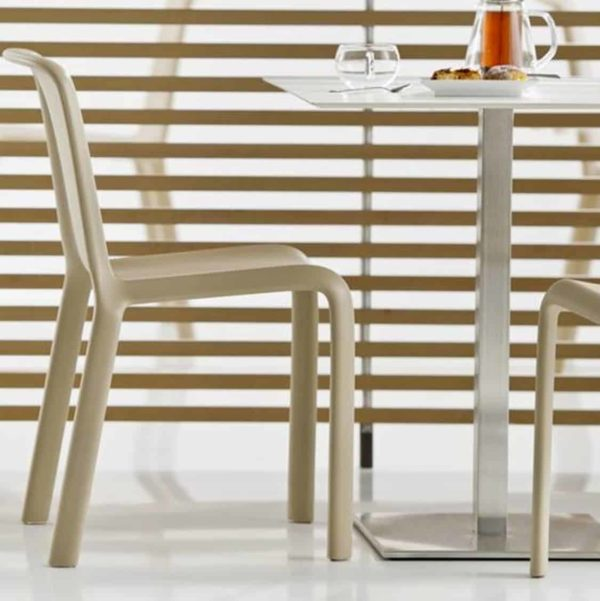 Snow Side Chair Stackable Outdoor Chair Pedrali at DeFrae Contract Furniture Sand in situ