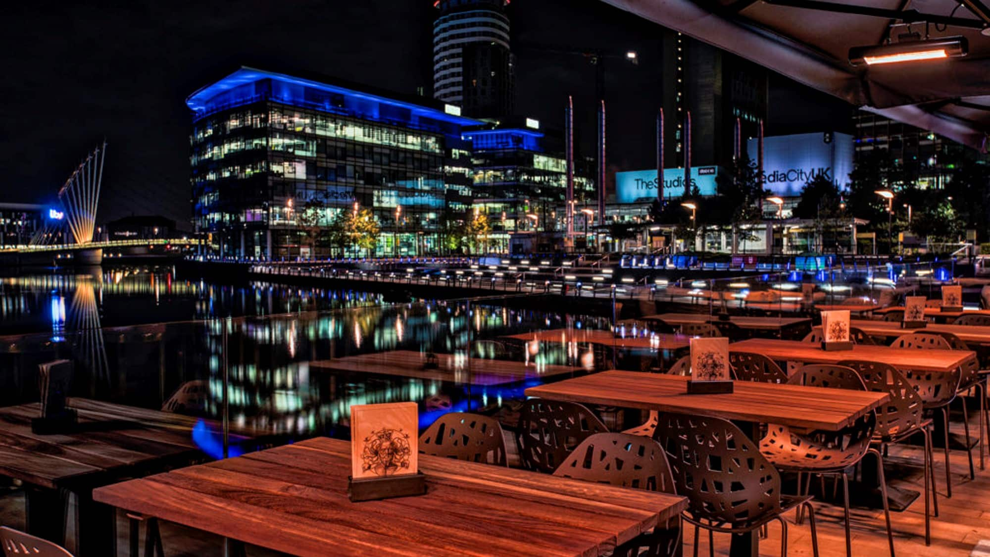 Pelotta outside bar stools and chairs at Alchemist Media City by DeFrae Contract Furniture Night View