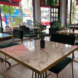 White levanto marble effect tabletops at Fed & Watered Acton by DeFrae Contract Furniture 2