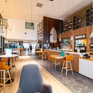 Ako bar stools and poseur tables by DeFrae Contract Furniture at Holiday Inn Winchester