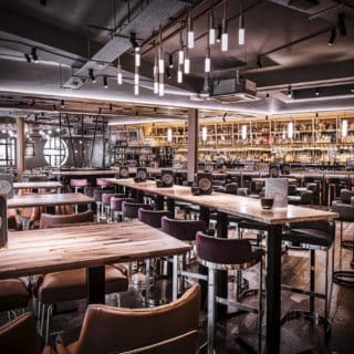 Glow side chairs and Louvre fluted back bar stools at Alchemist Brindley Place Birmingham by DeFrae Comtract Furniture