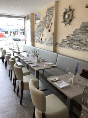 Mondellos-Restaurant-Plain-Back-Banquette-Seating-Ascot-Side-Chairs-and-Egger-Table-tops-with-Forza-tables-bases-by-DeFrae-Contract-Furniture