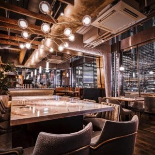 Glow side chairs and Louvre fluted back chairs and bar stools at Alchemist Canary Wharf by DeFrae Contract Furniture