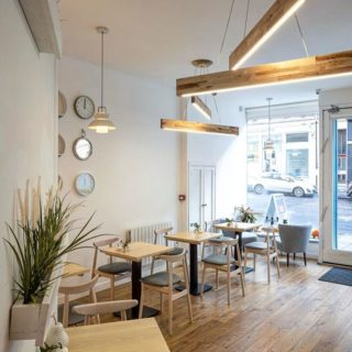 Michelle chairs solid wood tables with forza bases at Broken Clock cafe in Glasgow by DeFrae Contract Furniture