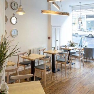 Michelle chairs solid wood tables with forza bases at Broken Clock cafe in Glasgow by DeFrae Contract Furniture wide