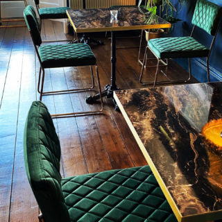 Marbled Cappuccino Laminate Tabletops with brass edging DeFrae Contract Furniture at Foyers Lodge
