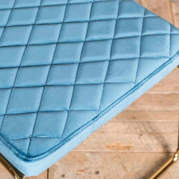 Marilyn Side Chair Quilted Back and Brass Look Frame DeFrae Contract Furniture Stackable Ocean Teal Blue Close Up