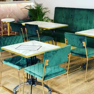 Marilyn side chairs and Marble laminate tabletops by DeFrae Contract Furniture at Fed & Watered Acton