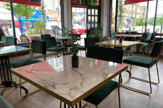 White levanto marble effect tabletops at Fed & Watered Acton by DeFrae Contract Furniture